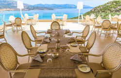 Servered table in restaurant on the sea. Servered table in authentic restaurant on the sea royalty free stock photo