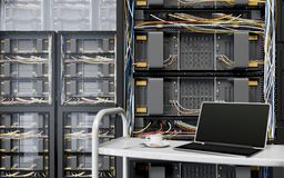 Servers and hardware room with notebook and coffee cup computer technology closeup photo Royalty Free Stock Photo