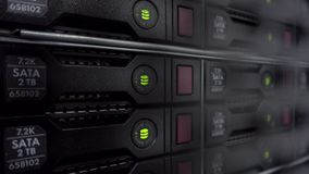 Servers stack with hard drives in a datacenter for backup and data storage. Close up shot. Blink led green. Servers stack with hard drives in a datacenter for stock footage