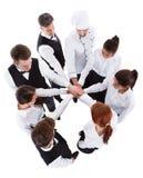 Serveurs et serveuses empilant des mains Photo libre de droits