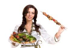 Serveurs portant des plats avec de la viande Image libre de droits