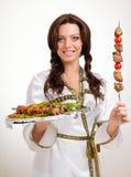 Serveurs portant des plats avec de la viande sur le blanc Photos stock