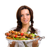 Serveurs portant des plats avec de la viande sur le blanc Photo stock