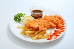 Serviço da costeleta da galinha na placa Foto de Stock