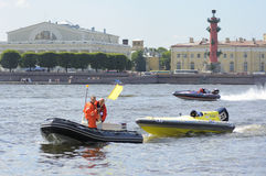 Servic� boat evacuates a sports motorboat. World Championship Endurance Pneumatics Class 1/2/3/4/5 24 hours St.-Petersburg July, 5-6th 2008 royalty free stock photography