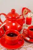 Service à thé rouge de porcelaine Image stock