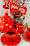 Service à thé rouge de porcelaine Photos libres de droits