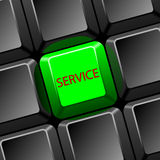 Service. Black keyboard with green  button for service Royalty Free Stock Photos
