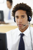 Service Agent Talking To Customer In Call Centre Royalty Free Stock Photography