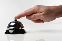 Service bell. Someone's hand pressing a service bell what could they want Royalty Free Stock Images