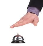 Service bell. Close-up of man holding hand upon the service bell while isolated on white Stock Images
