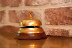 Service bell at an french cafe. Service bell at an at an french cafe in front of break wall Royalty Free Stock Images