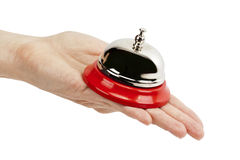 Service bell on a hand Royalty Free Stock Images