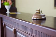 Service bell in a hotel reception for concierge alarm on desk. Royalty Free Stock Photography