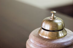 Service bell in a hotel reception for concierge alarm on desk. Stock Photos
