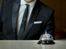 Service bell and the receptionist. Hotel service bell and the receptionist Royalty Free Stock Images