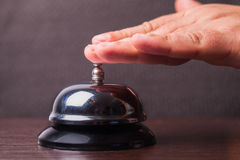 Service bell ring. Close-up finger that presses of the service bell ring Royalty Free Stock Photography