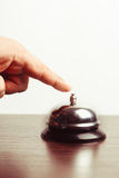 Service bell ring. Close-up finger that presses of the service bell ring Stock Photography