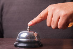 Service bell ring. Close-up finger that presses of the service bell ring Royalty Free Stock Photos