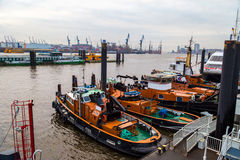 Service boats anchored in Baumwall area of Hamburg Port Stock Images