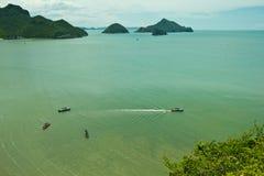 Service boats to island Stock Photo