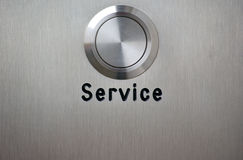Service button on brushed steel Stock Images