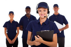 Service call center. IT service call center operator with headphones and team Royalty Free Stock Photos