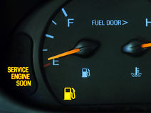 Service the Car. The service engine soon and gas light are lit up on a car Stock Photography