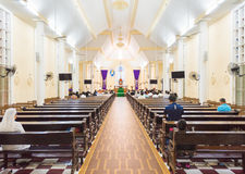Service at Catholic church, southern Vietnam. VUNG TAU, VIETNAM - MARCH 24, 2016: Unidentified people sit at public worship in the Nha tho Vung Tau Catholic royalty free stock image
