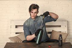 Service Center And Workshop Concept. Man Refilling Cartridge Toner For Printer Royalty Free Stock Photo