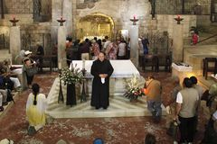 Service in the Church of Annunciation. Nazareth, Israel royalty free stock image