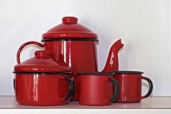 Service of coffee in red enamel, on white cabinet. Service of coffee in red enamel, typical of the Brazilian houses of the countryside and, today, objects of royalty free stock image