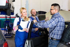 Service crew and driver near car Royalty Free Stock Image