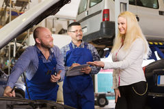 Service crew and happy driver Stock Photography