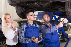 Service crew and satisfied drive Stock Image