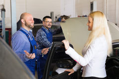 Service crew and satisfied drive Royalty Free Stock Image