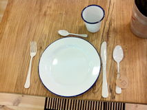 Service cutlery and plate. Stock Photos