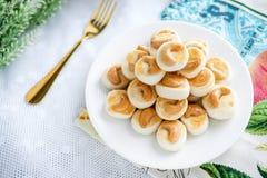 Service de biscuits de biscuit de Singapour avec le thé Photos libres de droits