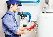 Service de chaufferette d'eau chaude Images libres de droits