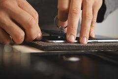 Service de repairment d'ordinateur et de téléphone photo stock
