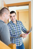 Service employee with tenant at doorway Royalty Free Stock Images