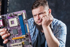 Service engineer fixing problem with motherboard Stock Photos