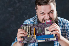 Service engineer repair computer motherboard Stock Photos