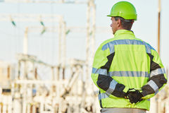 Service engineer standing in front of electro power plant Stock Image