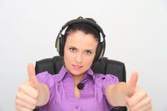 service för operatör för kundkvinnlighörlurar med mikrofon Arkivbilder