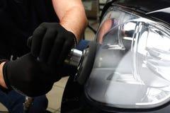 service för utbyte för bunkebilelevator lyftolja Polering av optik av bilen 3 Arkivbilder