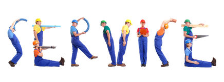 Service group. Group of young people wearing different color uniforms and hard hats forming Service word - isolated on white background royalty free stock image