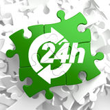 Service 24h Icon on Green Puzzle. 24 Hours Icon on Green Puzzle. Service Concept Royalty Free Stock Photography