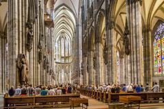 Service held in Central nave of Cologne Cathedral, Germany. COLOGNE, GERMANY- SEP 7, 2014: church service held in the cathedral in Cologne, Germany. The dome is royalty free stock photos
