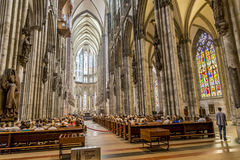 Service held in Central nave. COLOGNE, GERMANY- SEP 7, 2014: church service held in the cathedral in Cologne, Germany. The dome is Germanys most visited landmark stock images